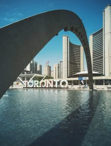 Toronto`s landmark surrounded by buildings.