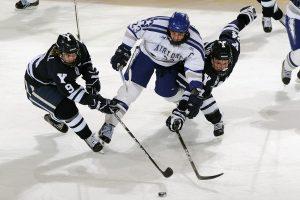 Hockey players playing hockey.
