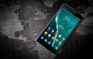 A cellphone on a world map.