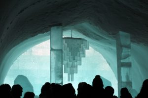 People standing in an ice hotel