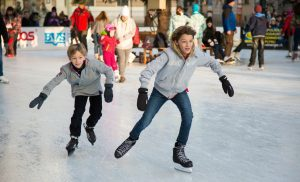 kids ice skating as one of the best thing to do in Toronto for Christmas