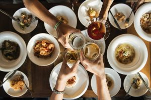 Meet new friends after moving - food and drinks at the table