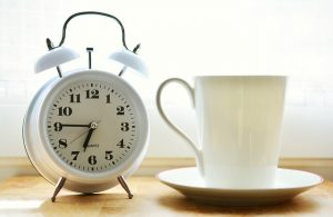 White Alarm clock and white mug