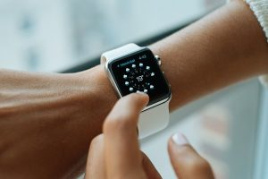 Woman looking at the weather forecast on her iwatch