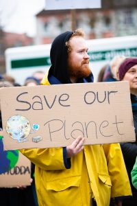 """Person holding """"Save our planet"""" sign"""