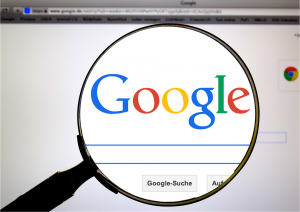 Google sign through a magnifying glass