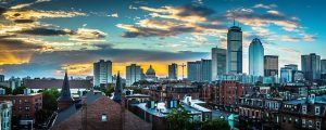 A panoramic view of downtown Boston at sunset.