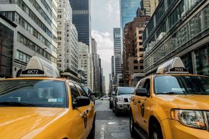 A view of a Manhattan street with yellow cabs.