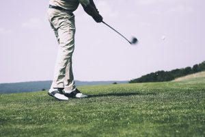 Man golfing on the course.