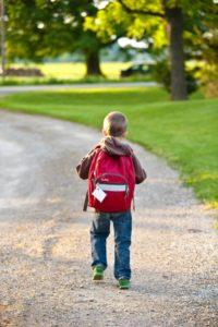 Kid with bag.