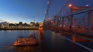Night photo of a bridge in Cincinnati, the city which is a perfect choice when moving from Canada to Ohio.