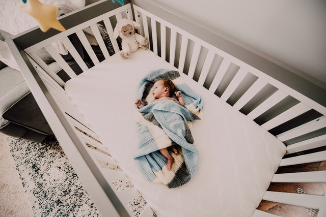 Baby sleeping in a a crib