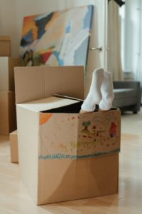 Kids feet sticking out of a cardboard box