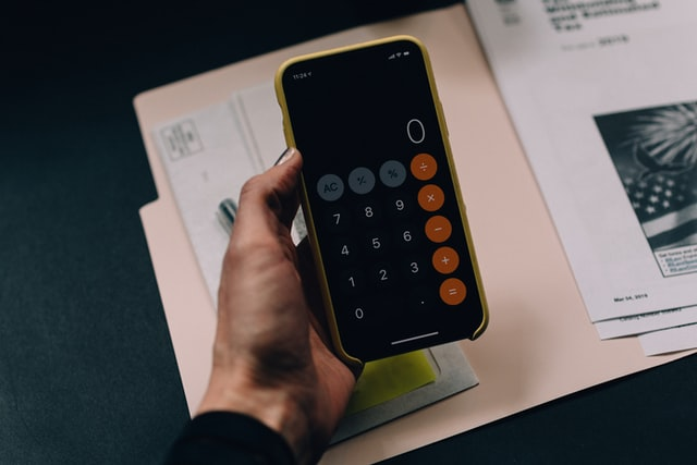 calculator on a mobile phone used to estimate moving costs