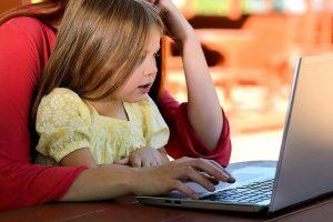 a girl using laptop