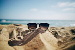 Black sunglasses left on the beach in one of the places where Canadians feel at home.