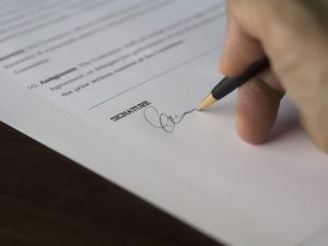 A signature on the paper.