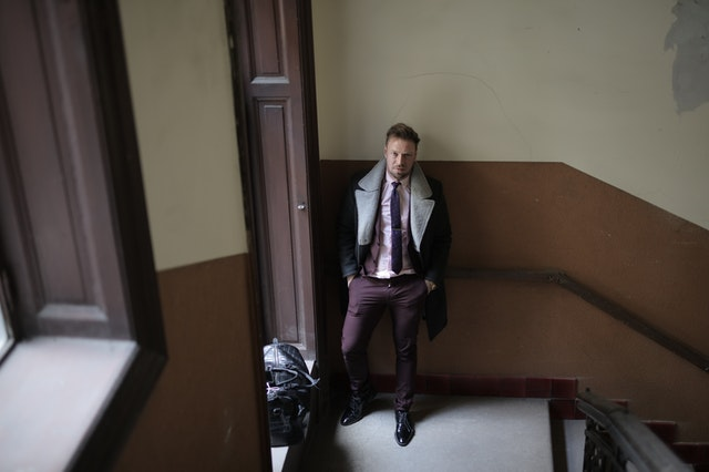 Man buying an NYC apartment as a non-resident standing in a hallway.