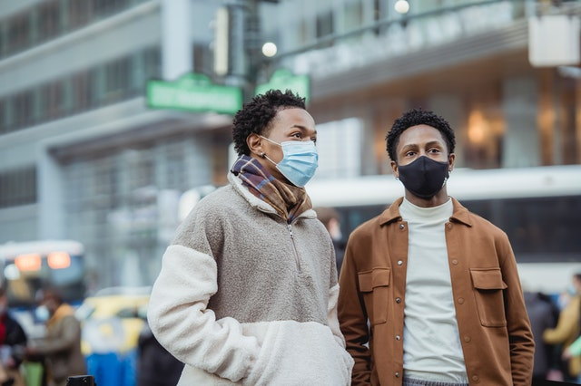 Couple wearing masks on the street.
