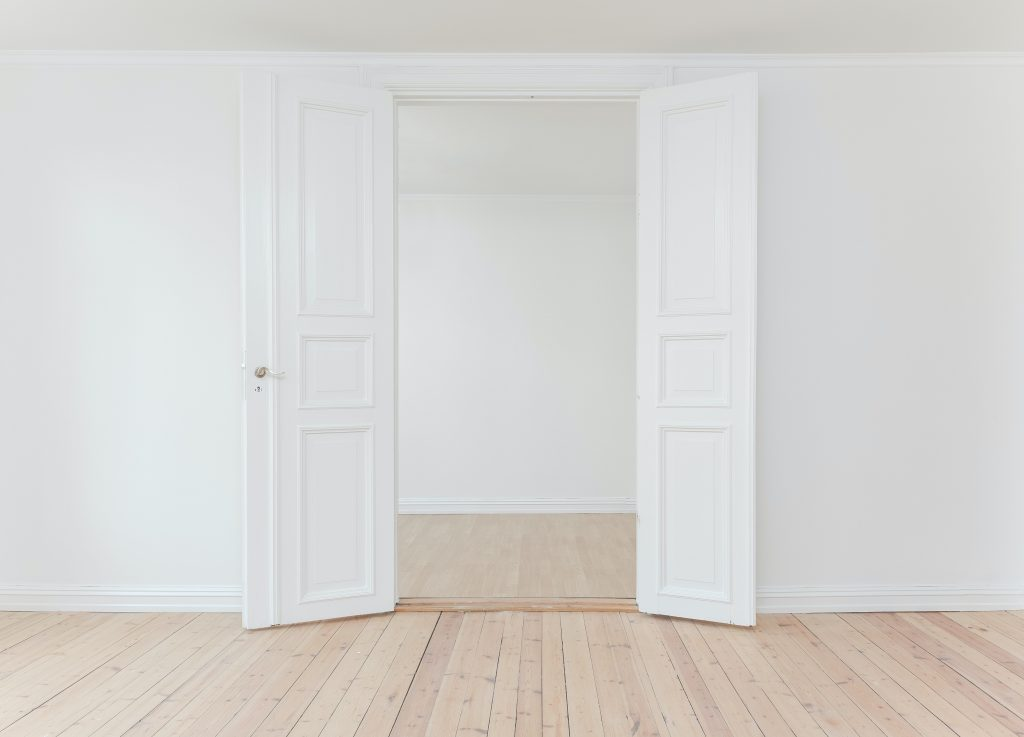 white door while touring an empty house
