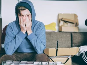 Man stressed out while packing for a move