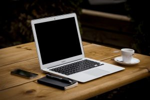 A laptop is useful to do research to find professionals when you are moving your construction business to Canada.