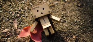 Cardboard toy robot on ground