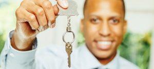 Man holding silver key
