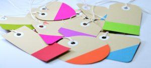 Cardboard tags on table