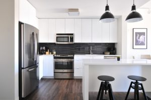 an image of a white and grey kitchen